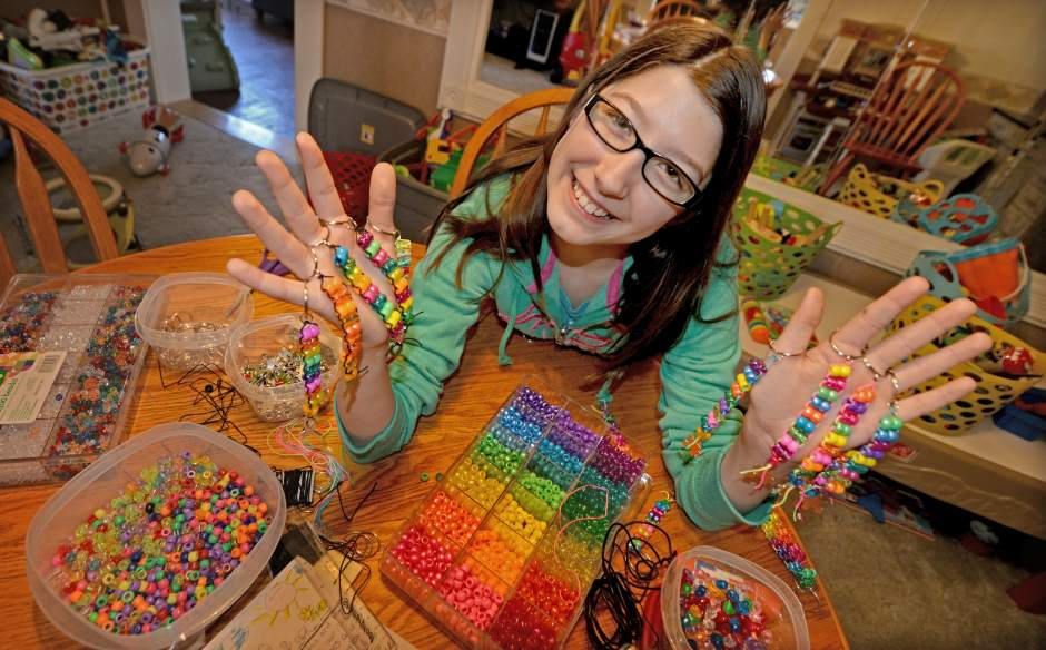 Young girl sells beaded key chains to for autism awareness and better understanding