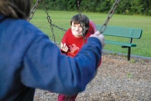 Vera Wilson, 50, who has cerebral palsy, swings at a West St. Paul park with her longtime caregiver Deb Peterson, who sees her once a week. Vera's parents have taken care of her at home her entire life, and will soon move her into a group home. (Kaitlyn Roby/Review)