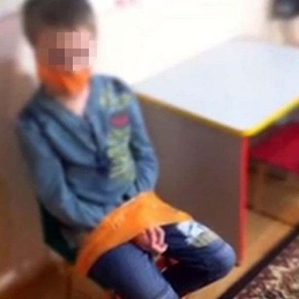 Disturbing leaked photo of young boy with autism tied to a chair with his mouth taped shut sparks outrage